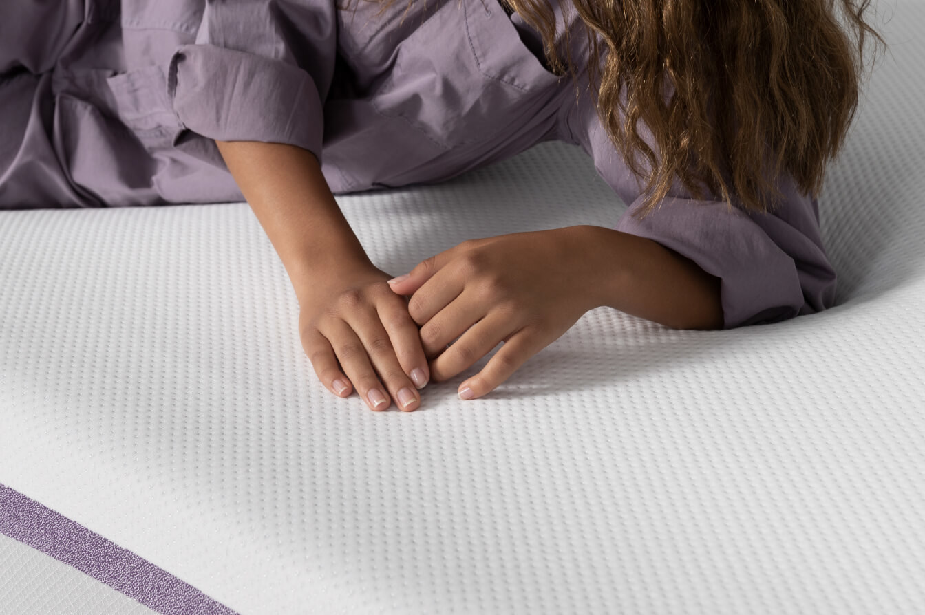 Teen Holding Hands On Purple Bed
